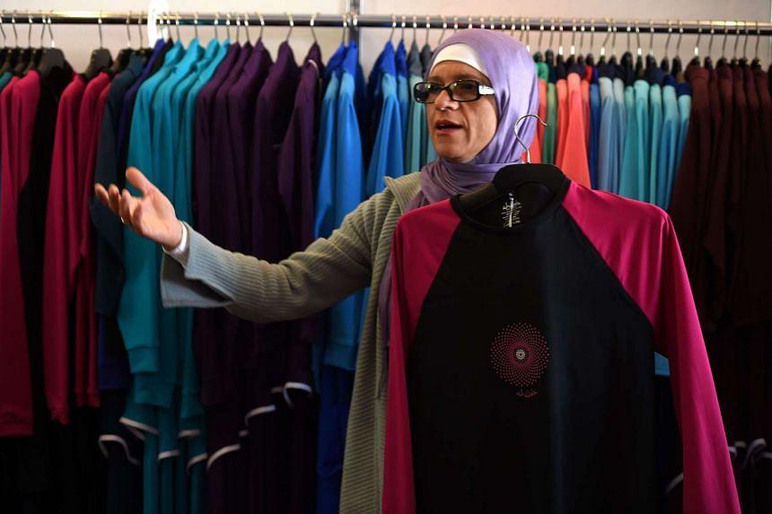 Australian-Lebanese designer Aheda Zanetti explains her burkini swimsuits at a shop in western Sydney.