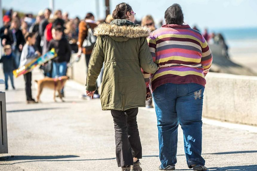 A report adds eight more kinds of cancer to the list of those already known to be more likely among overweight people.