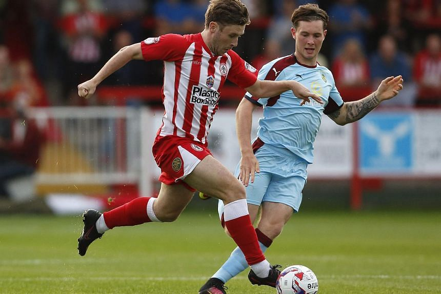 Players in action during the game between Burnley and Accrington Stanley.