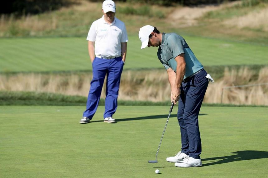 Rory McIlroy of Northern Ireland working with putting coach Phil Kenyon of England during the pro-am as a preview for The Barclays in the PGA Tour FedExCup Play-Offs on the Black Course at Bethpage State Park on Aug 24.