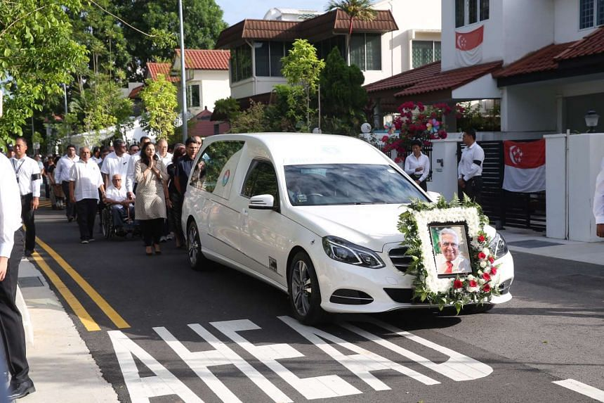 Former president S R Nathan's casket leaves his home on Ceylon Road for Parliament House on Aug 25.