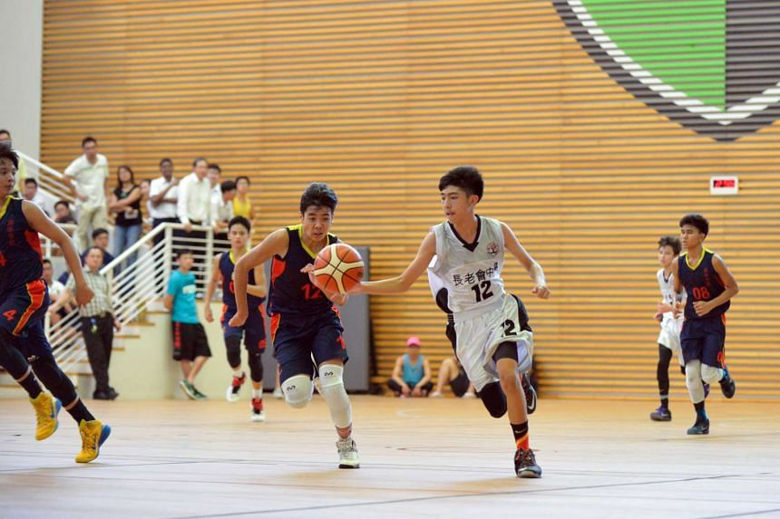 Point-guard Foo Yong Ming (in white), 14, told his team in the December holidays that he wanted to win the title and remain undefeated thoughout the season.