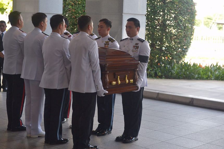 Former president S R Nathan's casket being carried to Parliament House on Aug 25.
