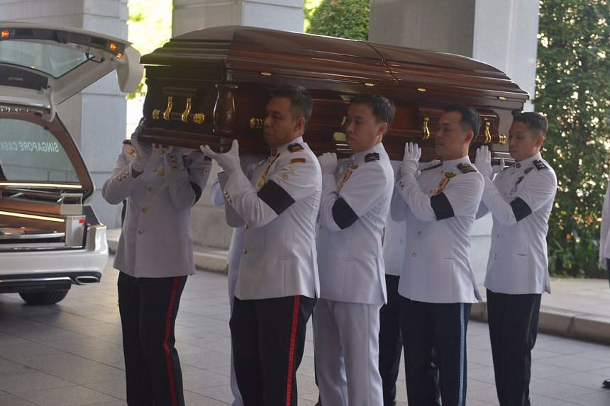 Mr S R Nathan's casket being carried out to Parliament House on Aug 25.