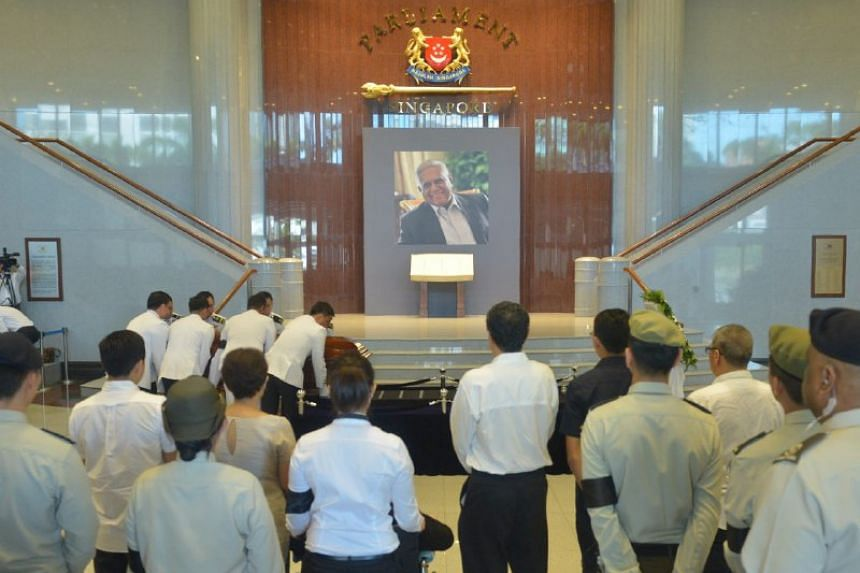 Former president S R Nathan's casket arrives at Parliament House on Aug 25.