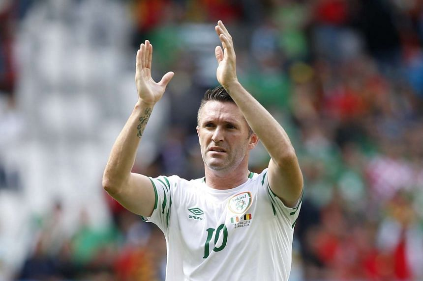 Republic of Ireland's Robbie Keane applauds fans after a game.