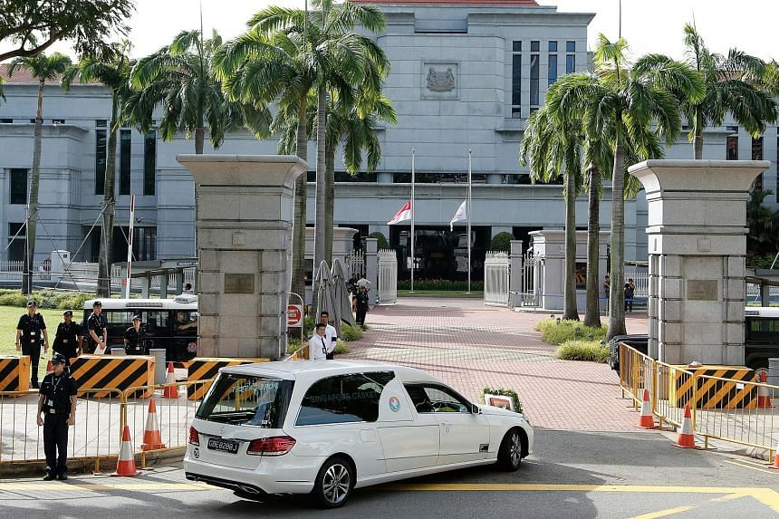 The casket bearing the body of former president S R Nathan arrives at the Parliament House on Aug 25.