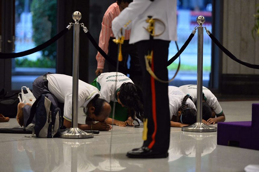 A group from Woodgrove Primary paying their last respects to former president S R Nathan at Parliament House..