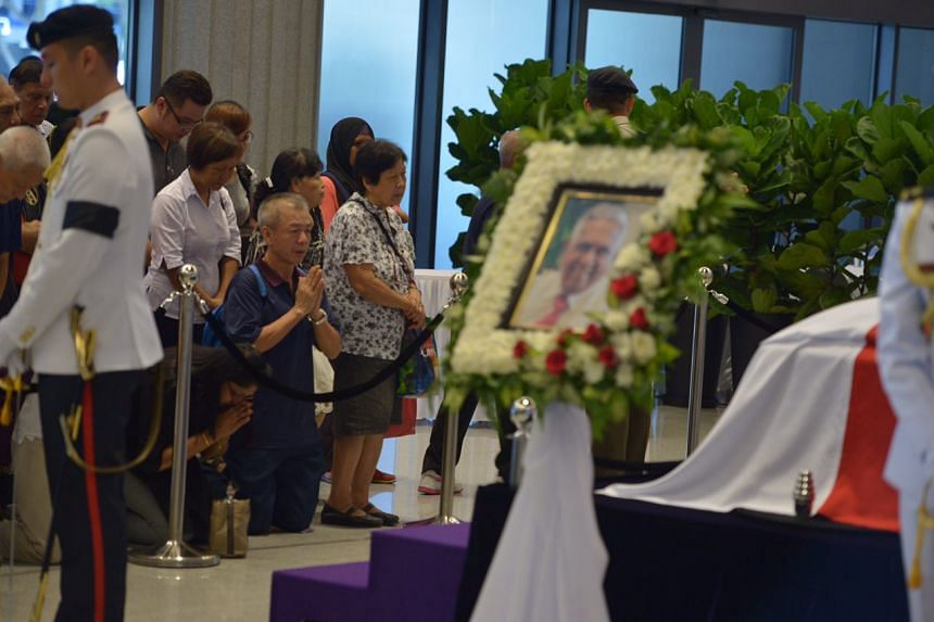 Members of the public paying their respects to Mr S R Nathan at Parliament House.