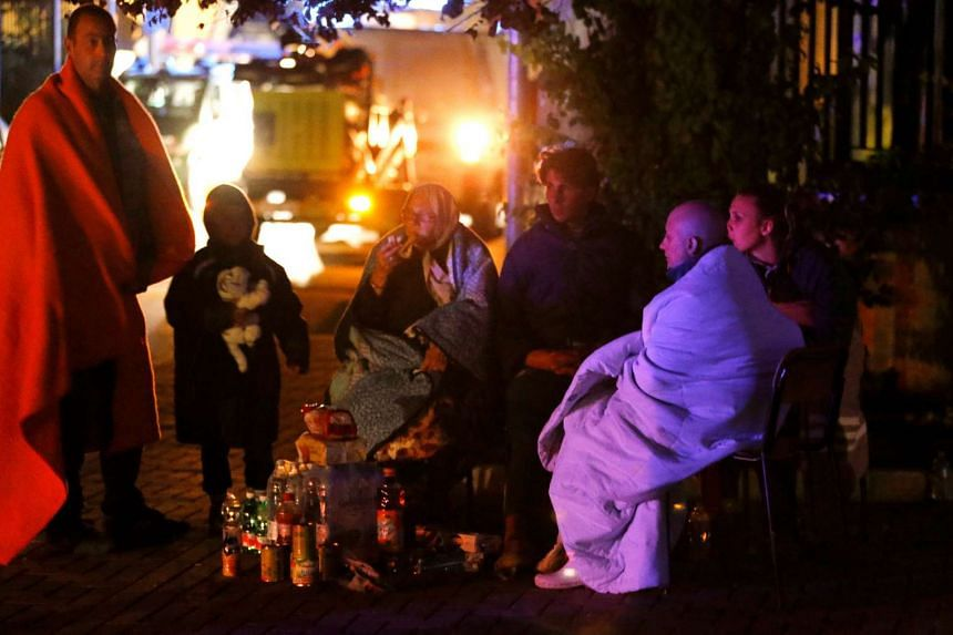 People prepare to spend the night in the open following an earthquake in Amatrice, central Italy, Aug 24, 2016.