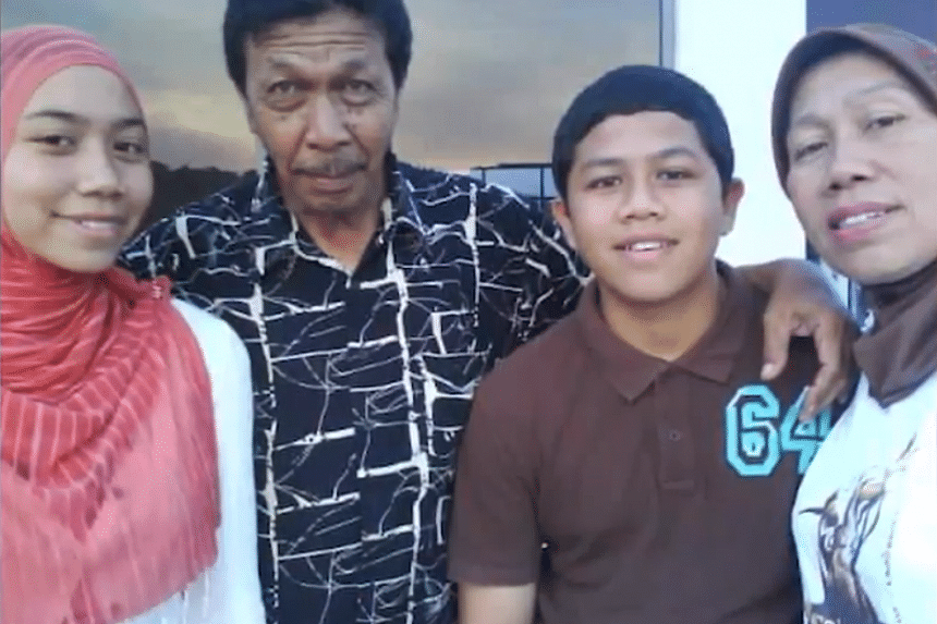 Maria Bahrin (right), her husband Hassan Wahab (2nd from left) and their son Taufik Hassan (2nd from right) were killed on Aug 25.