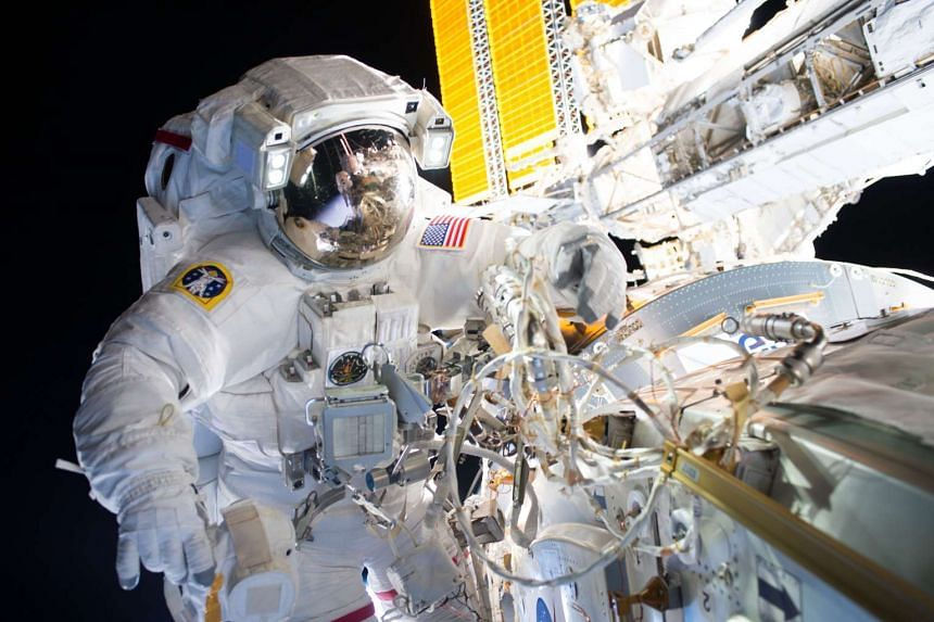 Commander Jeff Williams takes part in an ISS spacewalk to install the first of two international docking adapters on Aug 19, 2016.