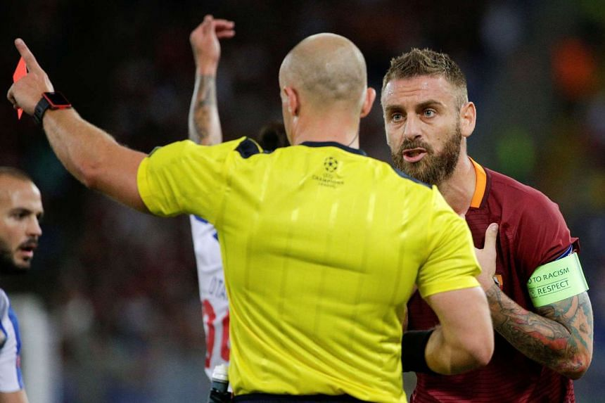 Midfielder Daniele de Rossi (right) pleading his case in vain after receiving the first of Roma's two red cards during the 3-0 defeat by Porto on Tuesday. The Serie A team, favoured to win despite drawing the first leg 1-1, never recovered after the visit