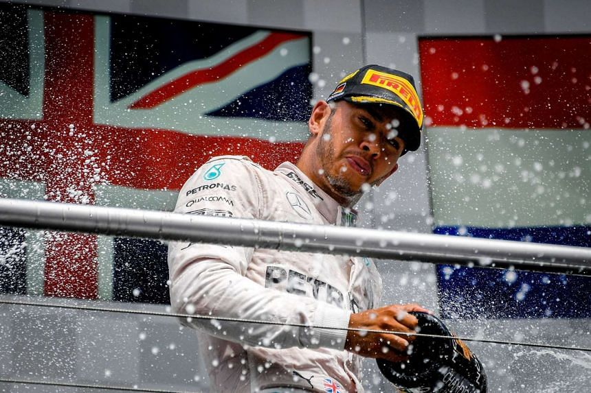 Mercedes driver Lewis Hamilton celebrates after emerging victorious at the German Grand Prix last month. As F1 returns from a break, the Briton is aiming to return to winning ways. He has won the last four races.