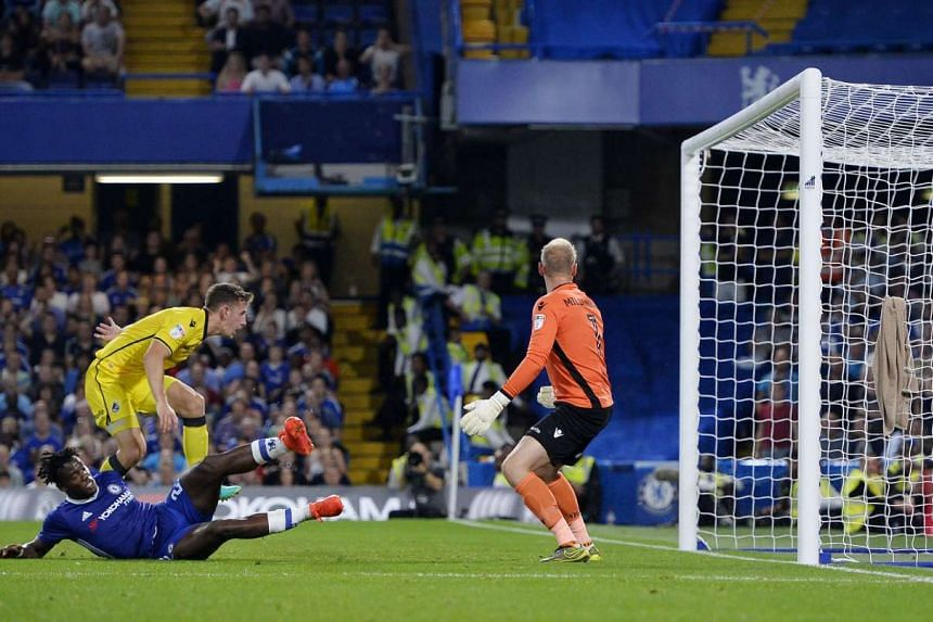 Chelsea's Michy Batshuayi loses his footing but scores his second goal in the tense 3-2 victory over Bristol Rovers on Tuesday to take the Blues into the third round of the League Cup.