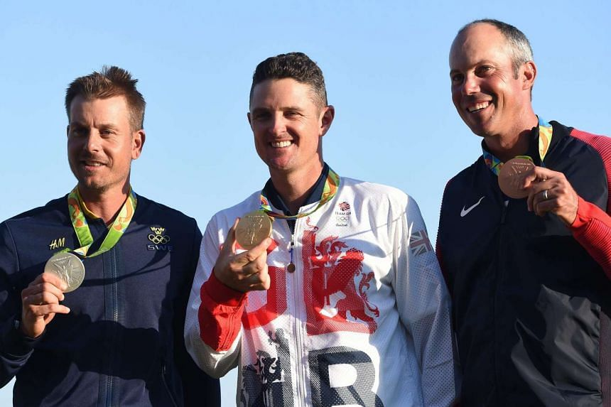 """Rio gold medallist Justin Rose (centre), flanked by Henrik Stenson (silver, left) and Matt Kuchar (bronze). Rose wants to ensure that his form at The Barclays shows he can """"put a run together""""."""