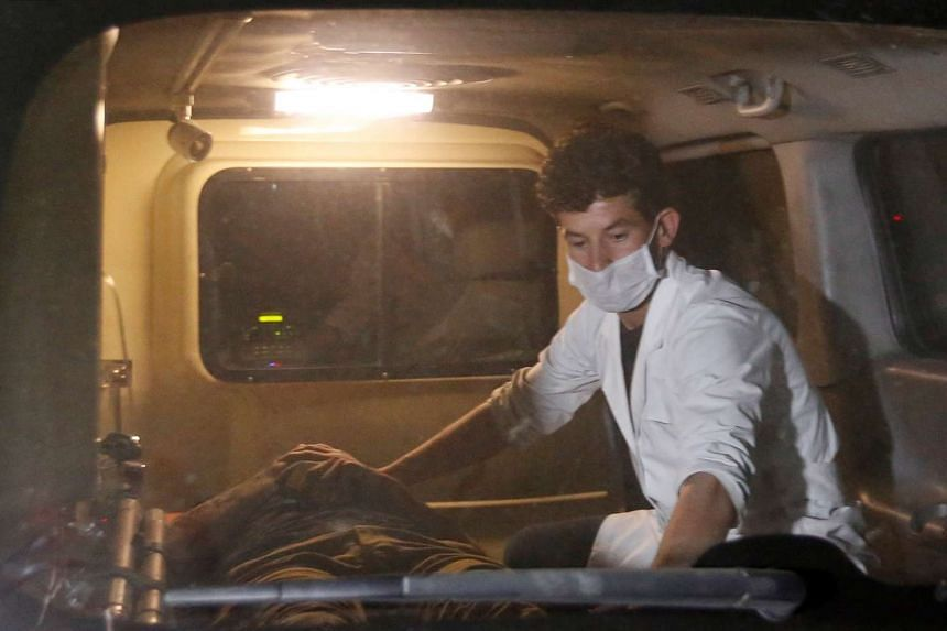 A wounded man lies inside an ambulance following the attack.