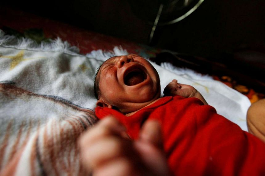 Eight-day old baby Allan, who was born with microcephaly, crying at home in Choluteca, Honduras, on July 29, 2016.