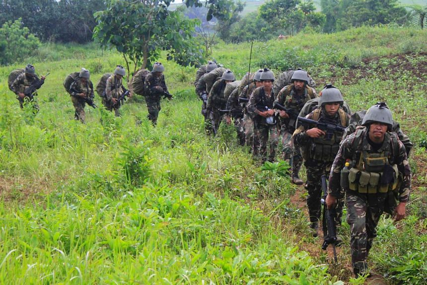 Philippine soldiers on patrol during an operation against ISIS at a remote village in Butig town, Lanao del Sur province, in the southern Philippine island of Mindanao on June 1, 2016.
