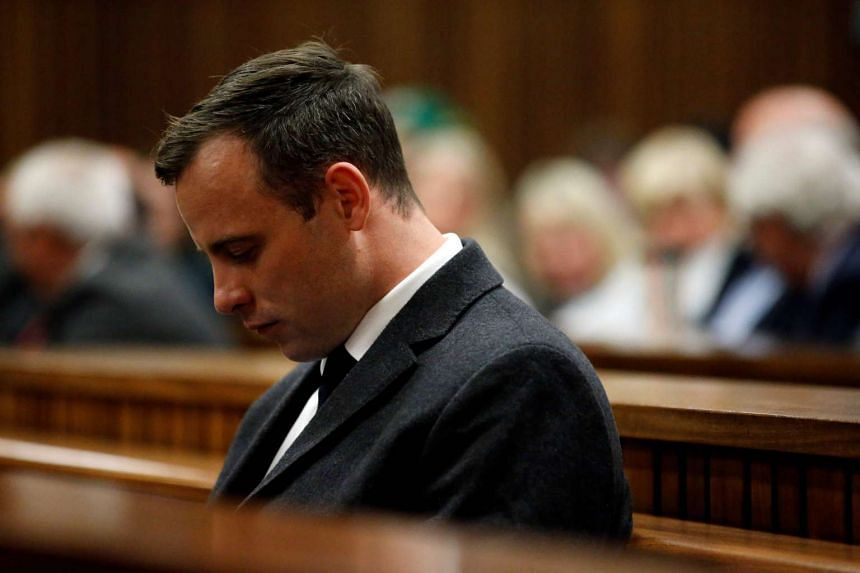 Paralympian athlete Oscar Pistorius looks on during the hearing in his murder trial at the High Court in Pretoria on July 6, 2016.