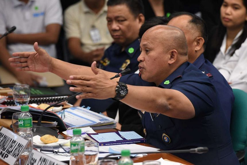 Philippine national police director general Ronald Dela Rosa gestures as he speaks during the second-day of a senate hearing in Manila on Aug 23, 2016.