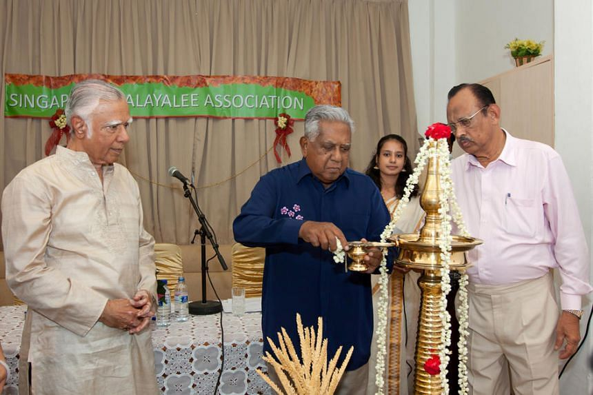 The late former president S R Nathan lighting the lamp watched by Mr Gopinath Pillai (left) and SMA president P K Koshy on Dec 12, 2011.