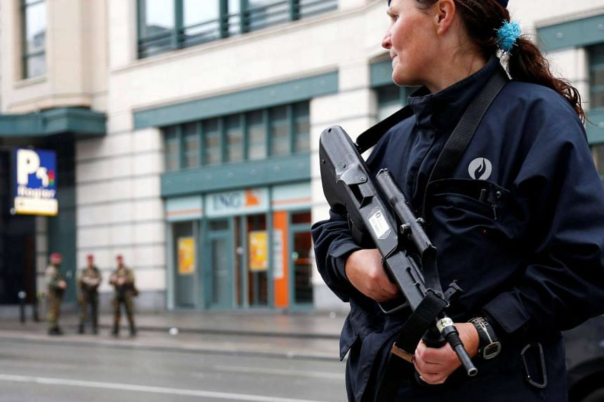 A Belgian police officer patrols near a central Brussels shopping centre on June 21. An explosion in Chimay on August 26 was the latest incident to strike the country.