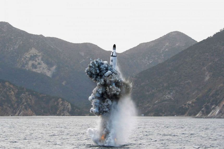 An underwater test-firing of a strategic submarine ballistic missile is seen in this undated photo released by North Korea's Korean Central News Agency (KCNA).