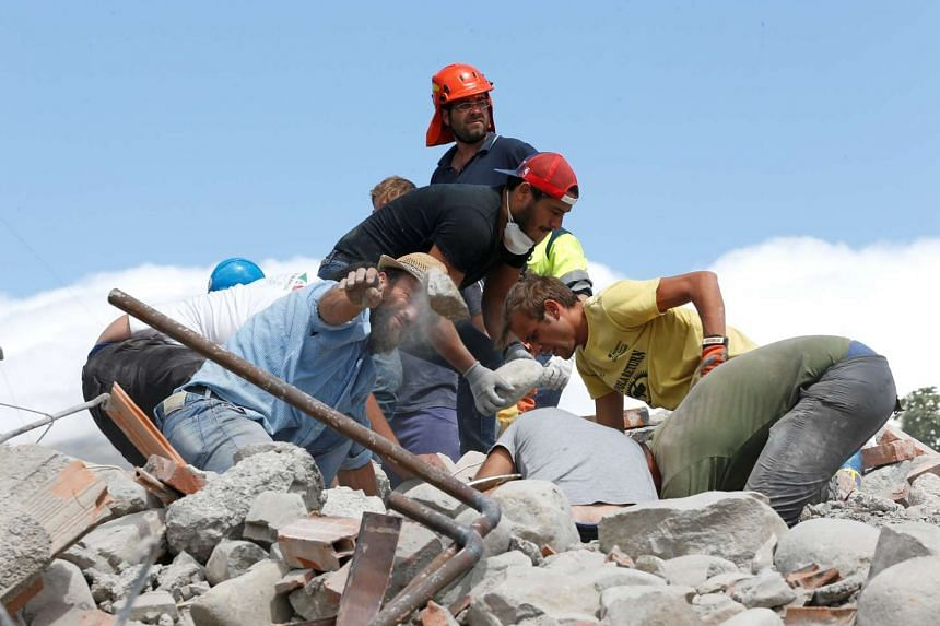 Rescuers work following an earthquake in Amatrice, central Italy, August 24.
