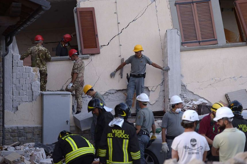 Volunteers assist rescue and emergency services personnel at the damaged Hotel Rome in the central Italian village of Amatrice, August 25.