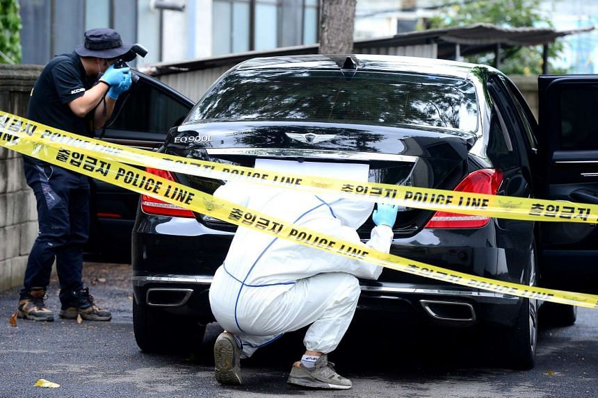 Inspectors examining the car owned by Lotte Group vice-chairman Lee In Won at a police station in Yangpyeong, South Korea, on Aug 26, 2016.