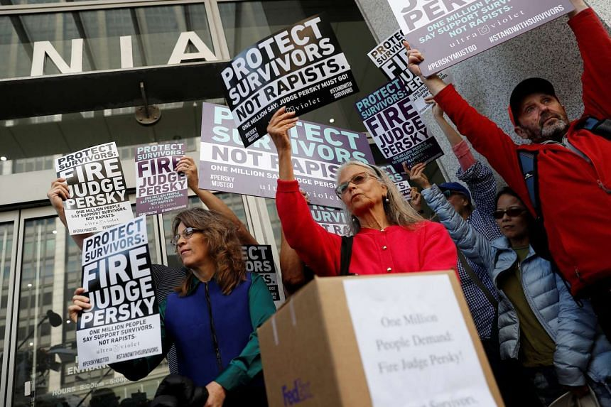 Activists hold signs calling for the removal of Judge Aaron Persky from the bench after his controversial sentencing in the Stanford rape case, in San Francisco, California, US on June 10.