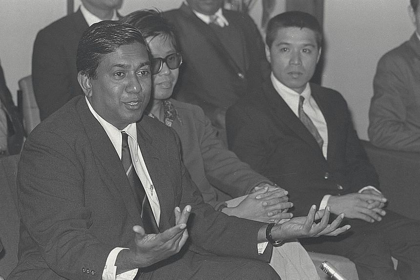Mr Nathan speaking to reporters after he and his team arrived back in Singapore safely on Feb 9, 1974. The brave group of 13 men had flown with the terrorists to Kuwait after they demanded that a group of guarantors accompany them on the flight. Terr