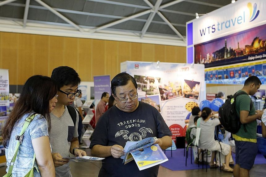 More travellers, including visitors at the Natas travel fair (left) earlier this month, are buying travel insurance or as part of their travel packages.