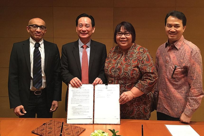 From left: Singapore Ambassador to Indonesia Anil Kumar Nayar, Pavilion Energy's group chief executive officer Seah Moon Ming; Pertamina's new and renewable energy director Yenni Andayani and Pertamina's senior vice-president of gas and power Djohard