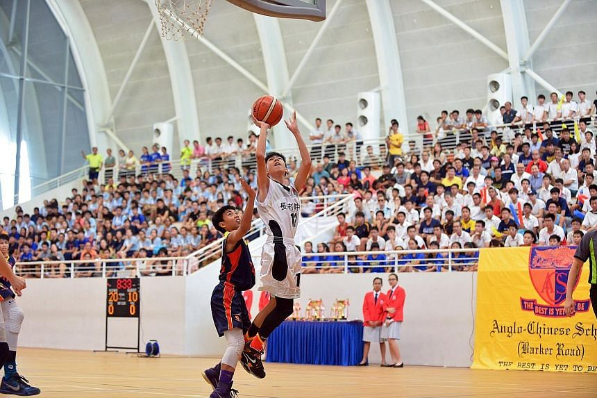Presbyterian High School's Foo Yong Ming shooting during yesterday's 78-43 victory against Anglo-Chinese School (Barker Road) in the Schools National C Division final.