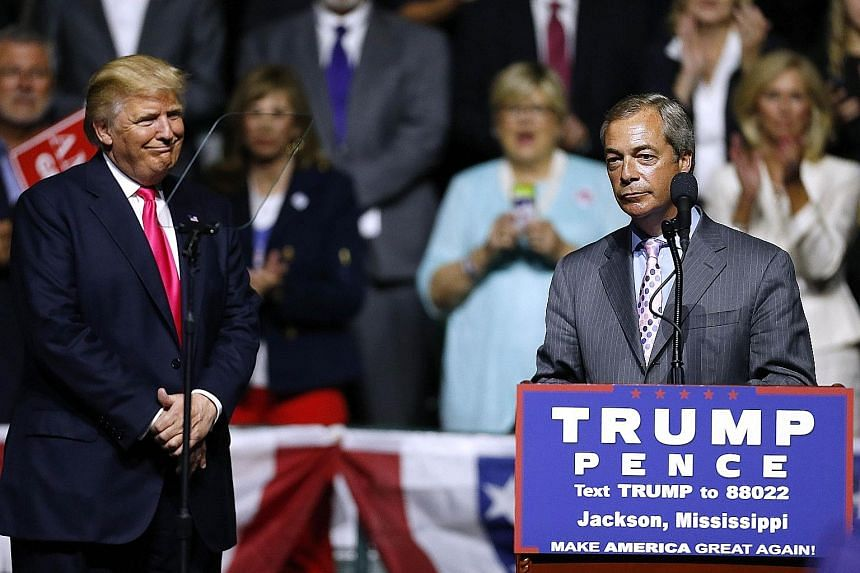 Mr Farage (right), former leader of United Kingdom Independence Party, appeared with Mr Trump (left) before a cheering crowd of thousands at a rally in Jackson, Mississippi, on Wednesday.