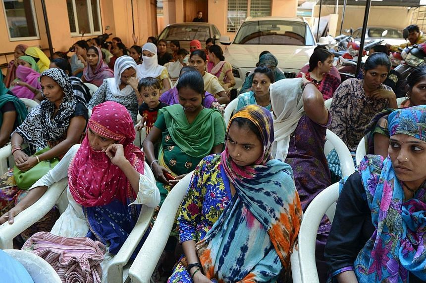 Surrogate mothers protesting last October against an Indian Council of Medical Research ban on foreign couples using Indian surrogates, at Kaival Hospital in Anand, some 90km from Ahmedabad. The current draft law will allow only infertile local coupl