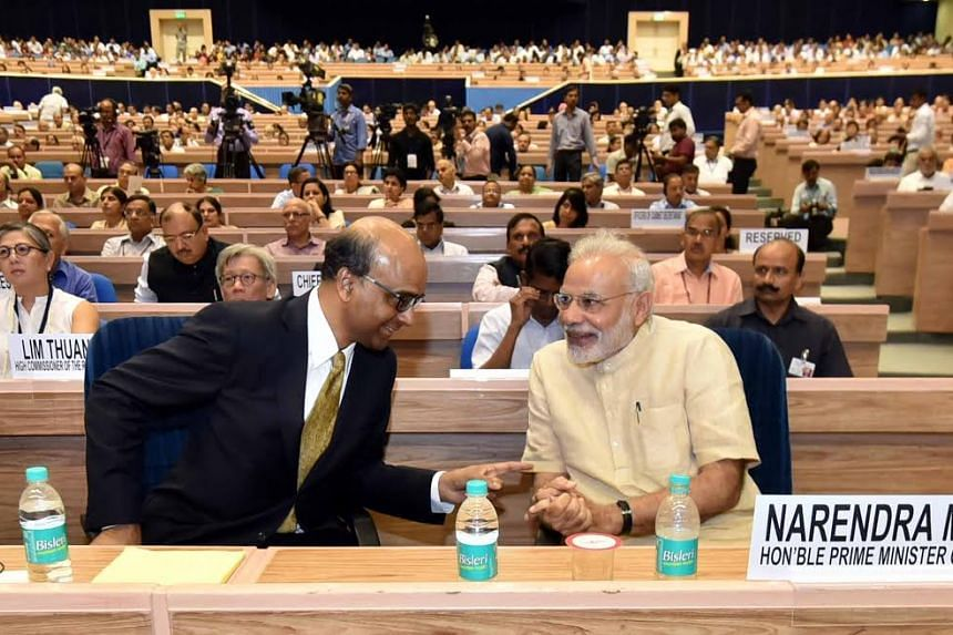 Singapore's Deputy Prime Minister Tharman Shanmugaratnam with Indian Prime Minister Narendra Modi at the inauguration ceremony of the NITI 'Transforming India' Lecture Series in New Delhi on Aug 26, 2016.