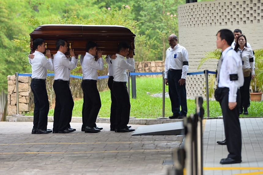 The pall bearers carrying the coffin of the late former president S R Nathan into the Mandai Crematorium, on Aug 26, 2016.