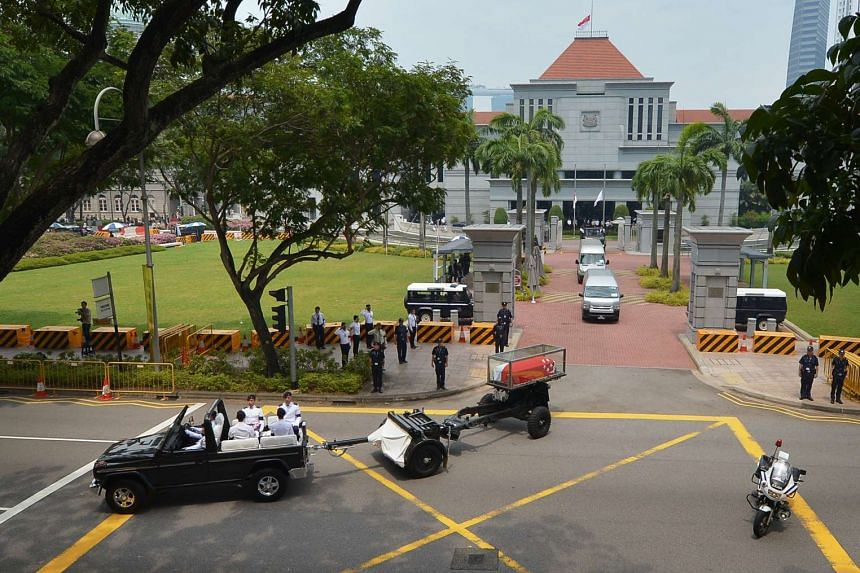 The gun carriage carrying the late former president S R Nathan's flag-draped coffin leaving Parliament House, on Aug 26, 2016.