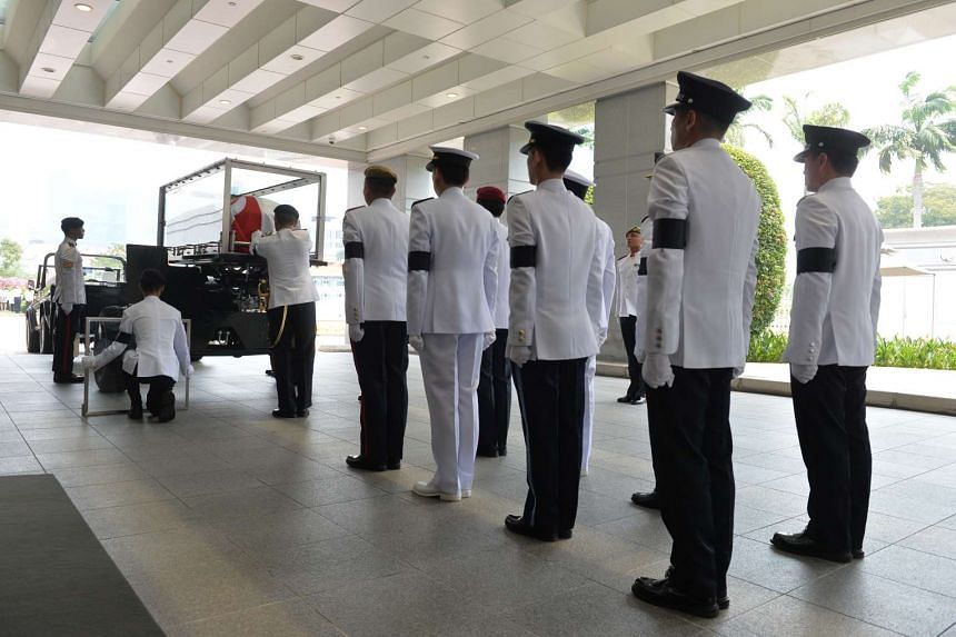 The pallbearers standing to attention as the coffin of the late former president S R Nathan is placed on the gun carriage on Aug 26, 2016.