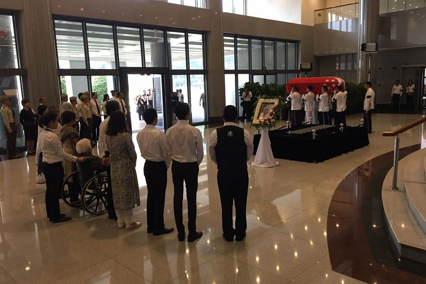 The family of the late former president S R Nathan watching as the pallbearers carry his coffin out of Parliament House on Aug 26, 2016.