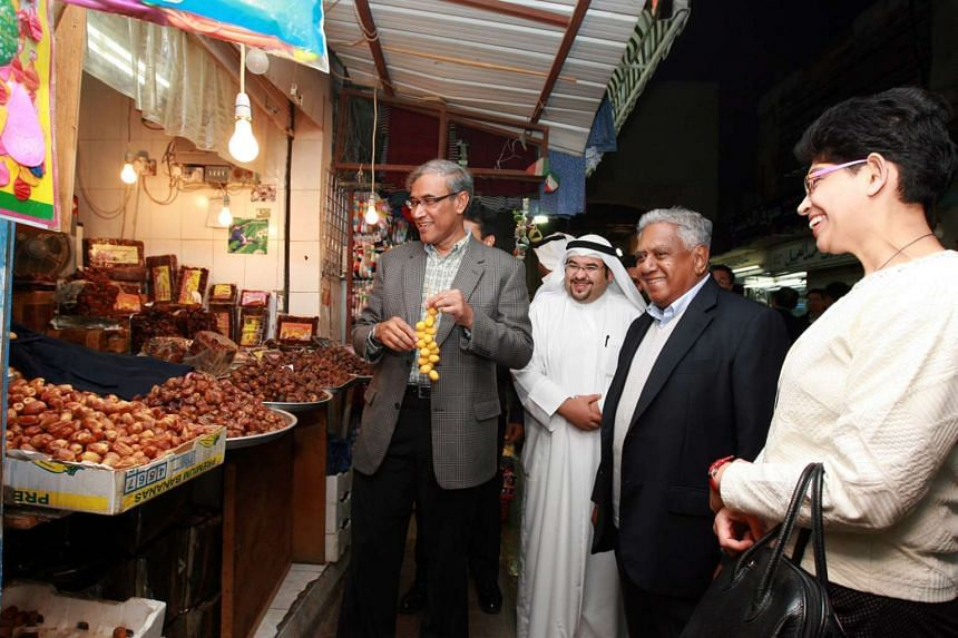 Mr Zainul and Mr Nathan on the former president's official visit to Kuwait in 2008.