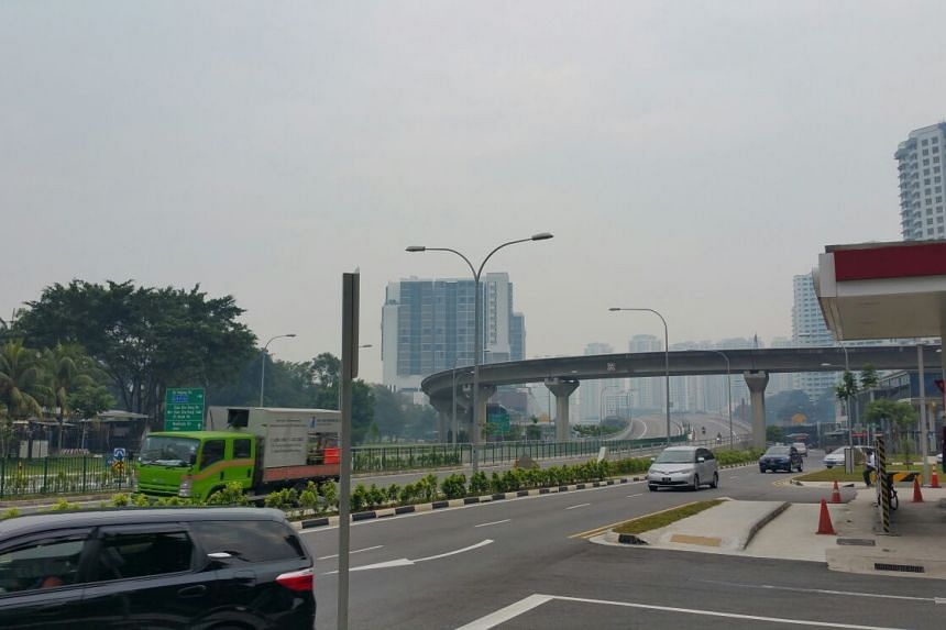 The hazy skyline seen at Upper Bukit Timah Road, at about 8.30am on Friday morning.