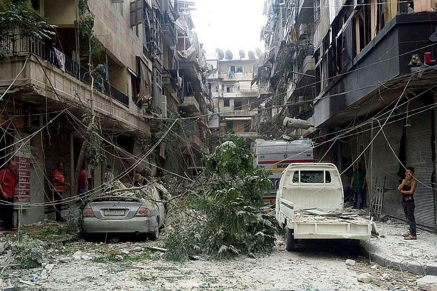 Syrian citizens inspect the damages caused by several rockets that hit residential neighborhoods in Aleppo, Syria on Aug 25, 2016.