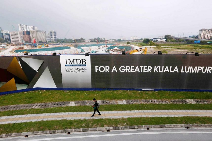 A man walks past a 1MDB development on Mar 1, 2015. Student activists plan for a mass rally on Aug 27 to call for the arrest of an unnamed official.