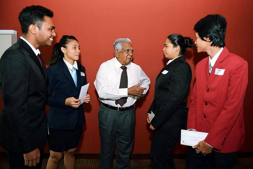Former Singapore President S R Nathan (centre) talking to students at the S R Nathan Education Upliftment Fund awards held on Oct 5, 2012.