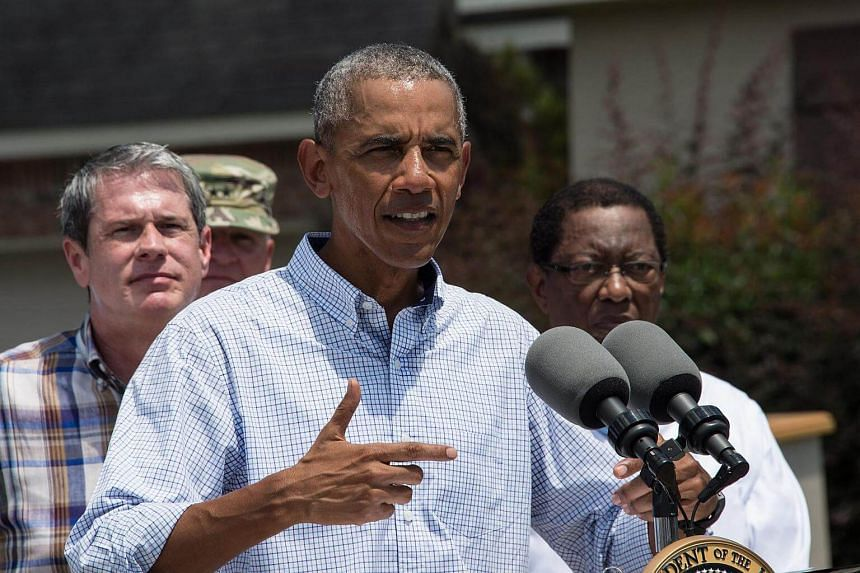 US President Barack Obama speaks after touring a flood-affected area in Baton Rouge, Louisiana, on Aug 23.