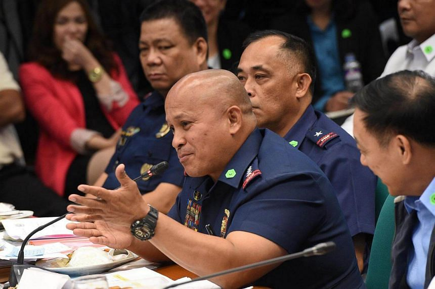 Philippine National Police director general Roland Dela Rosa, gesturing while speaking during the Senate inquiry into the alleged spate of extra judicial killings in the war against crime, on Aug 23, 2016.